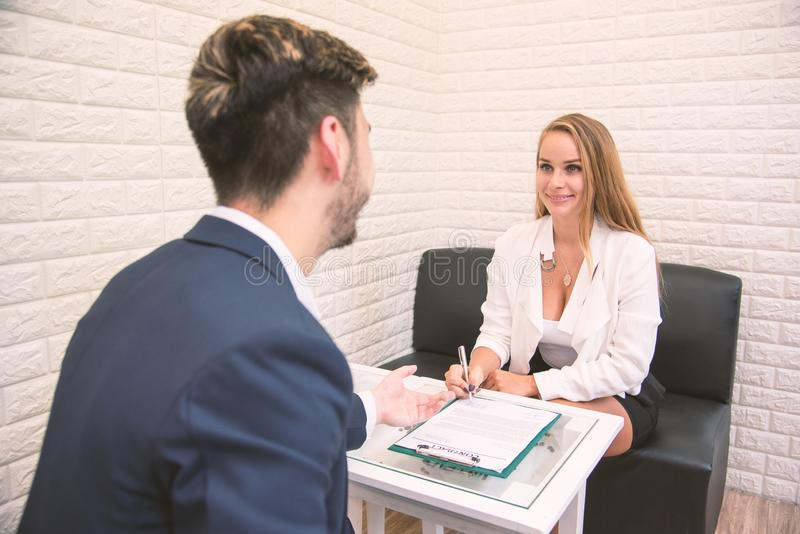 Business employer offering work to new employee extend agreement for signing to successful applicant, hiring new staff concept, stock image