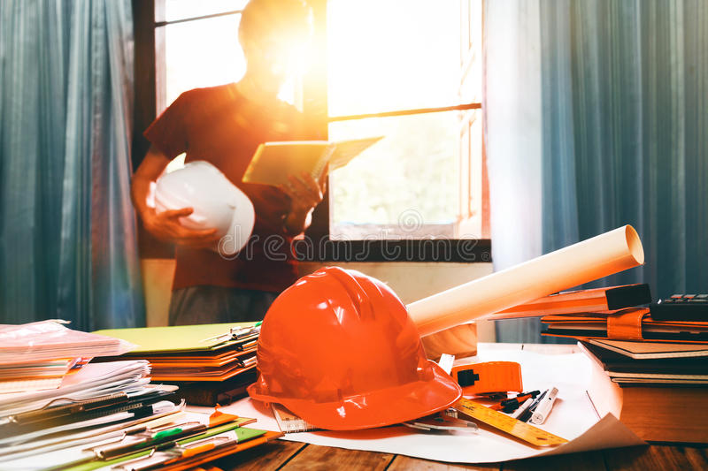 Business engineer working hard at his desk in apartment home building concept at construction site main office. royalty free stock image