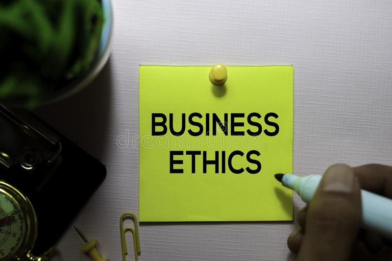 Business Ethics text on sticky notes isolated on office desk royalty free stock photos