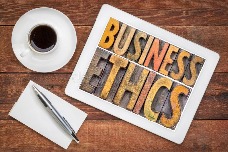 Business ethics word abstract on tablet stock image