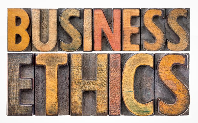 Business ethics word abstract in wood type royalty free stock photo