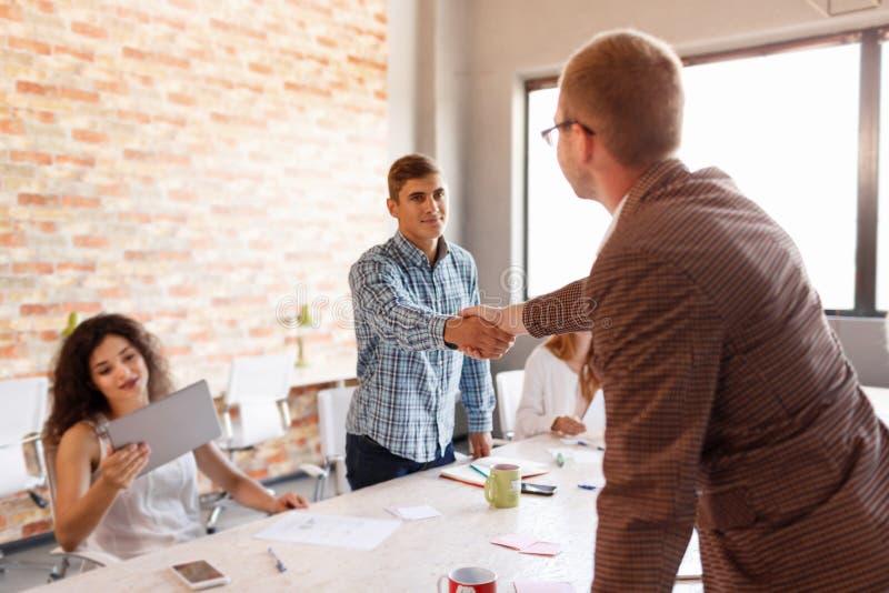 Business etiquette, entrepreneurs partnership, making successful deal. Business partnership meeting concept. Image businessmans handshake. Successful stock photos