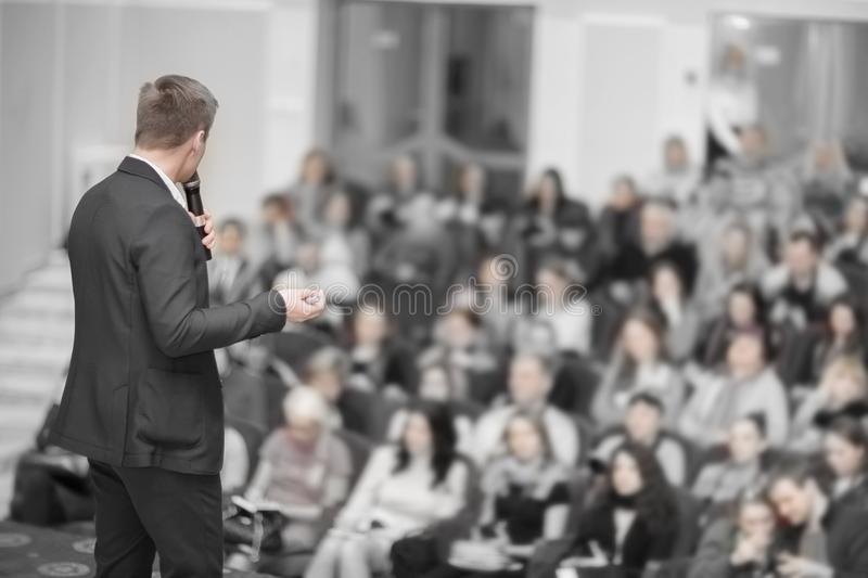 Speaker conducts the business conference for journalists and aspiring entrepreneurs. Business event.the speaker and the Audience in the conference room. Business stock photography