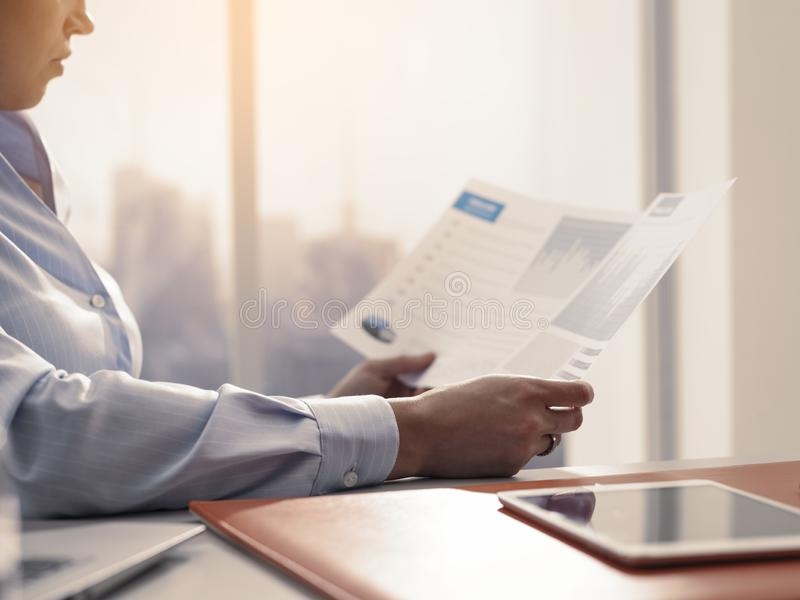 Business executive checking financial reports in the office stock images