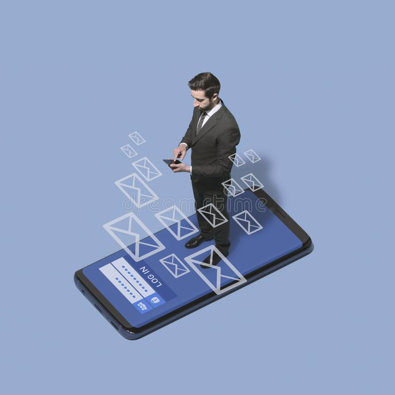 Business executive checking his messages on the phone stock image