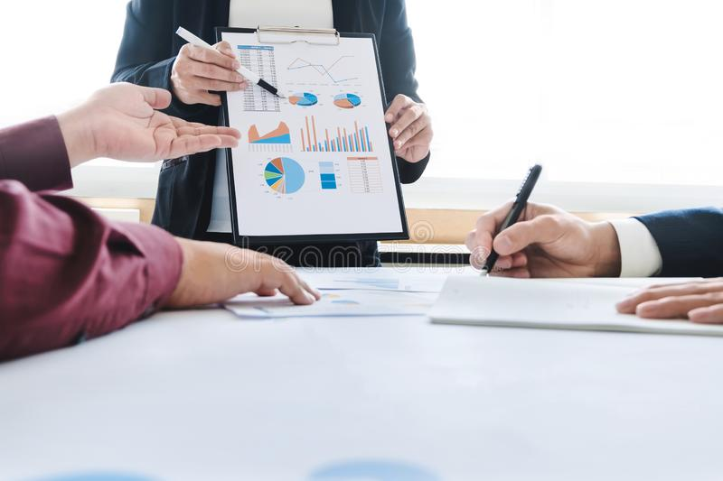 Business executive colleagues working together with analysis data documents at a office stock image