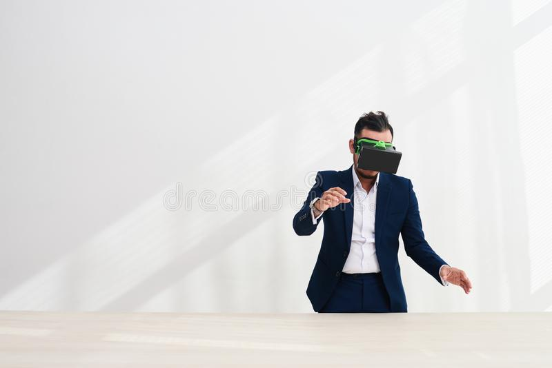 Businessman working in virtual reality glasses royalty free stock photo