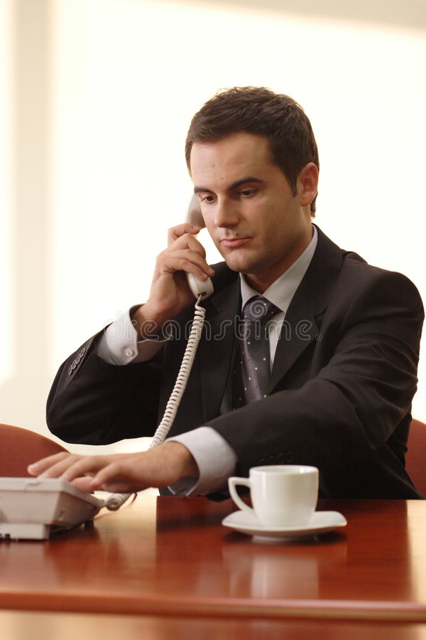 Business executive on phone stock images