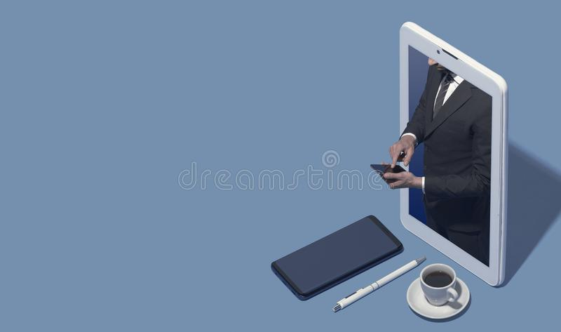 Business executive in a smartphone using his phone stock photos