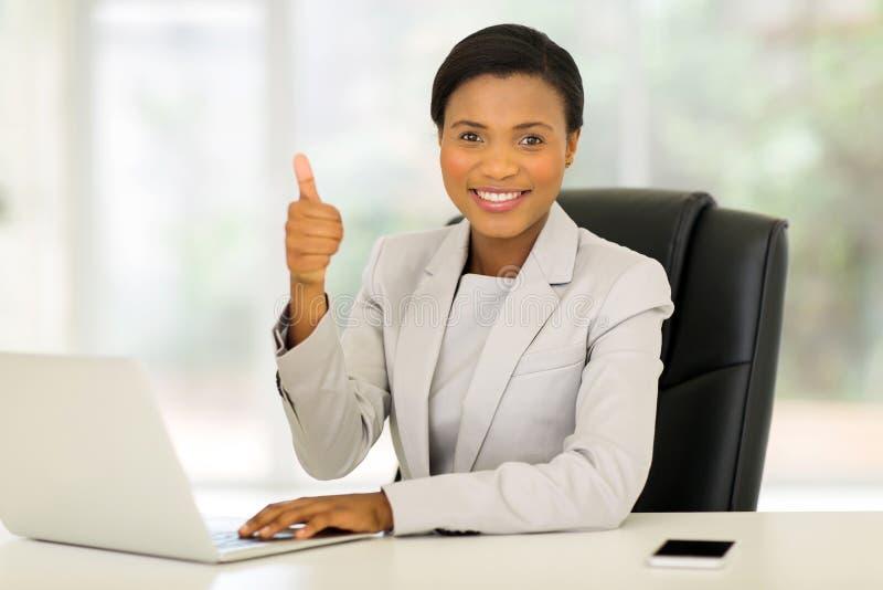 Business executive thumb up royalty free stock image