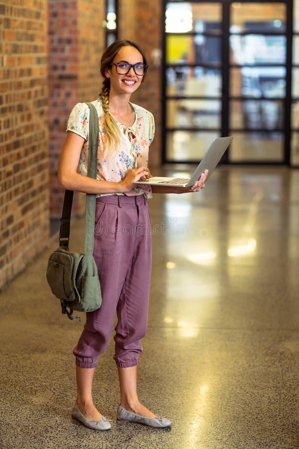 Business executive using laptop stock photo
