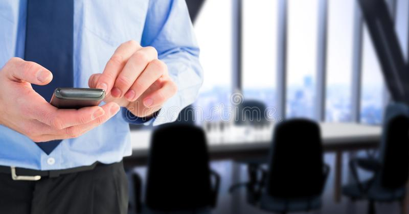 Business executive using smart phone in office royalty free stock photography