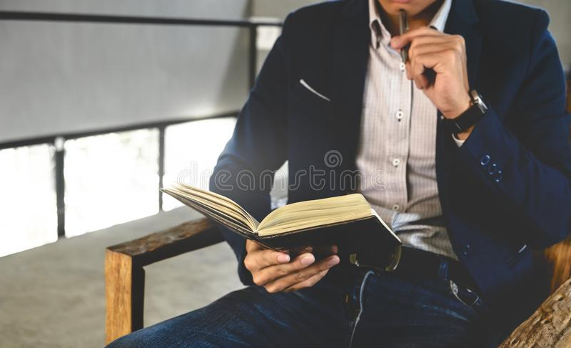 Business executive working at modern office / cafe stock image