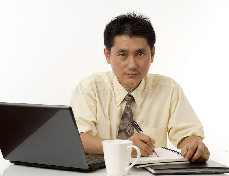 Business executive writing stock image