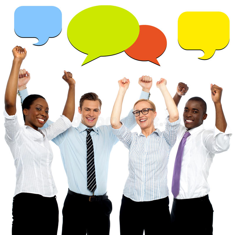 Business executives celebrating their success. Successful business people with colorful speech bubbles stock photo