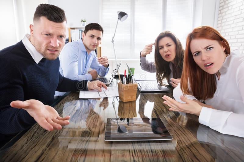Business Executives Complaining In Office. Group Of Business Executives Complaining Toward Camera In Office stock image