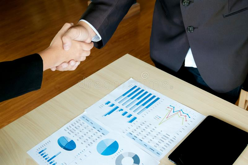 Business executives handshaking agreement project deal at a office stock photography