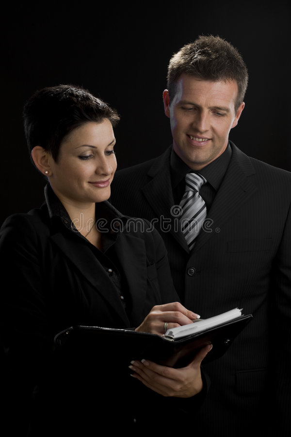 business executives smiling στοκ φωτογραφία με δικαίωμα ελεύθερης χρήσης