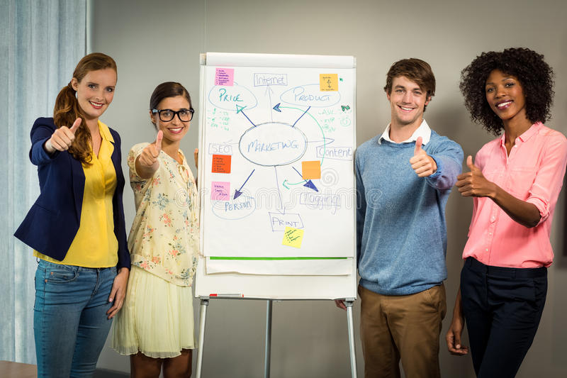 Business executives standing with flowchart on white board. In office royalty free stock photo