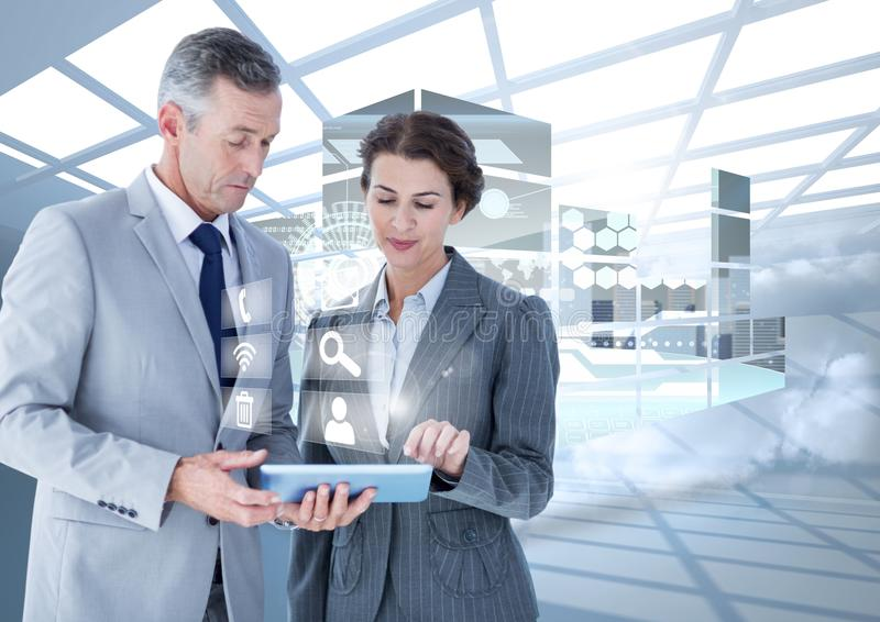 Business executives using digital tablet against digital interface in background royalty free stock photos