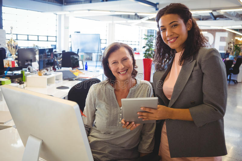 Business executives using digital tablet stock image