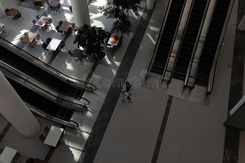 Business executives walking in office lobby. High angle view of business executives walking together in modern office lobby royalty free stock photo