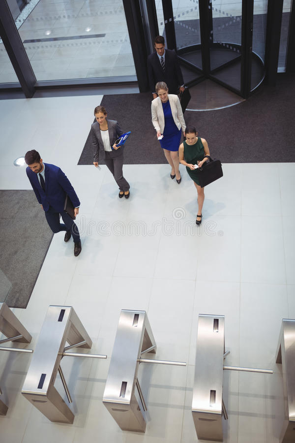 Business executives walking in the office stock photography