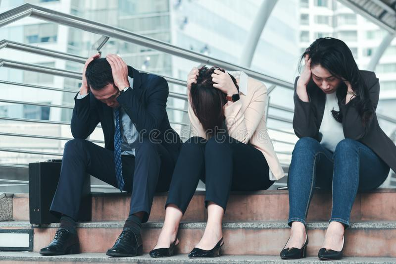 Business failure concept : businessman stressed sitting ,problem life balance. Selective focus stock photo
