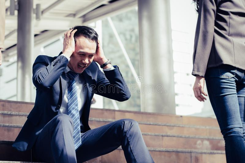 Business failure concept : businessman stressed sitting ,problem life balance. Selective focus royalty free stock images