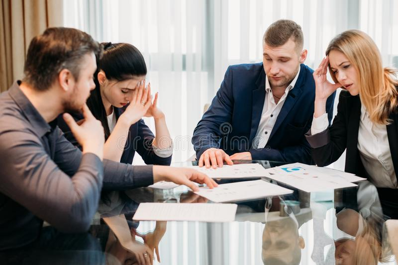 Business failure bankruptcy stressed defeated team. Business failure. prospective bankruptcy. stressed stunned crushed defeated team of company executives or stock photo
