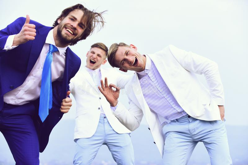 Business fashion, happy people in white and blue outfit, marketing royalty free stock image