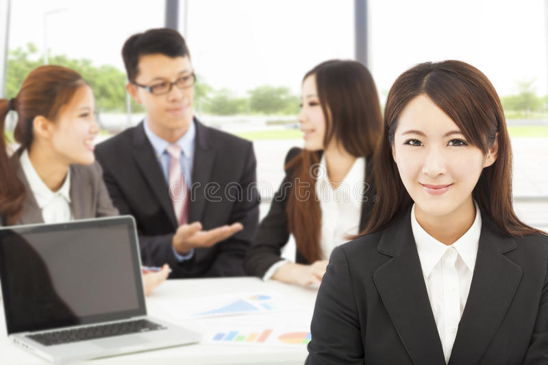 Business female manager with teams in the office. Young business female manager with teams in the office stock photography