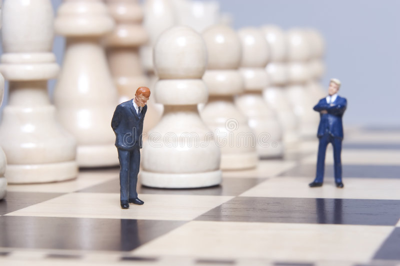 Business Figurine and chess royalty free stock photography