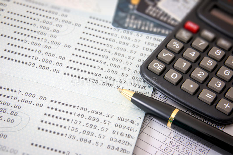 Business finance. Book bank, credit cards, the calculator, a ball pen. Business finance concept royalty free stock images