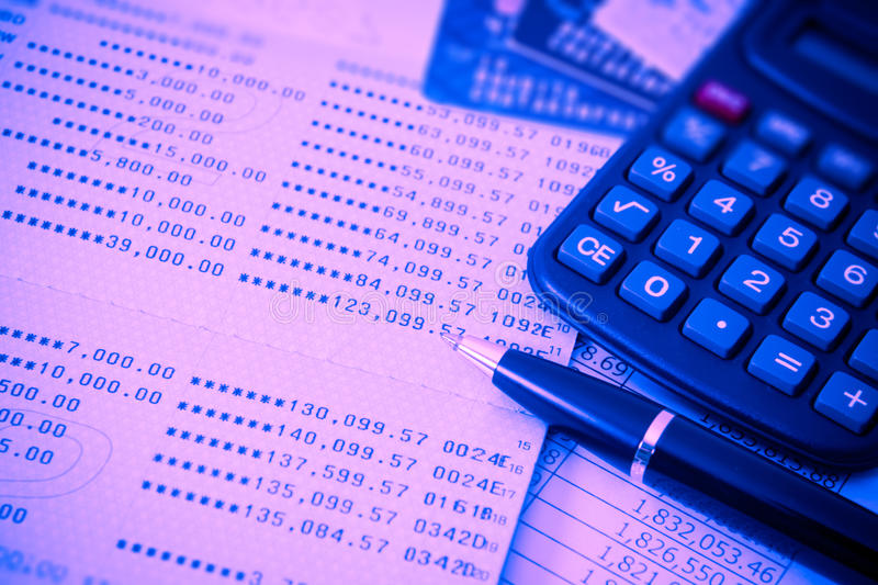 Business finance. Book bank, credit cards, the calculator, a ball pen. Business finance concept. filter red and blue effect style picture stock photo