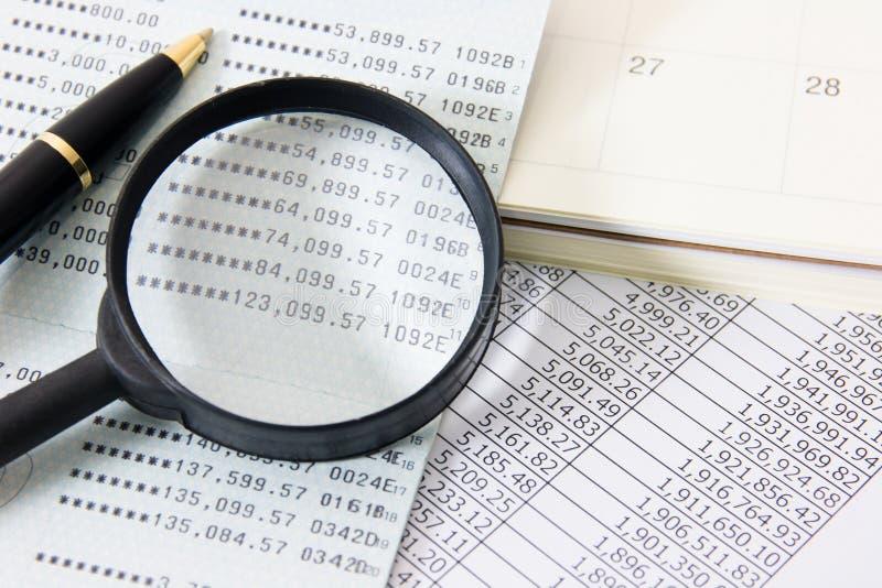 Business finance. Book bank, Magnifier, Calendar, a ball pen royalty free stock image
