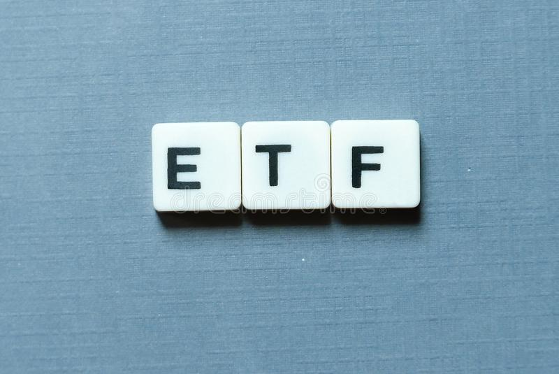 Business and finance concept. ETF& x28;Exchange Traded Fund& x29; letter on grey background. Business and finance concept. ETF& x28;Exchange Traded Fund& x29 stock photography