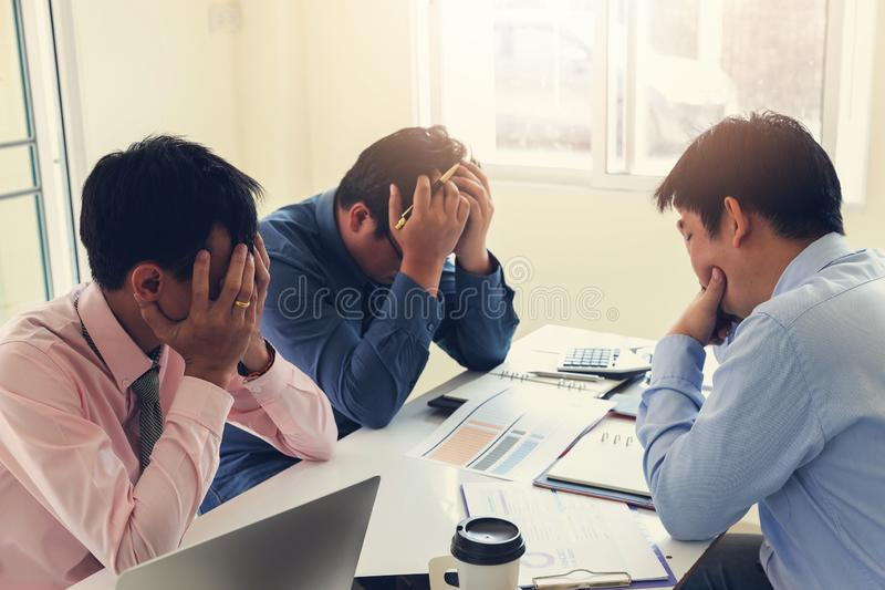 Business and finance concept of office working,Teamwork of Businessmen stressing after investment business plan not success royalty free stock images