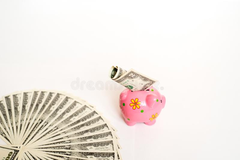 business, finance, investment, saving and corruption concept - close up of dollar cash money and piggy bank on table royalty free stock photo