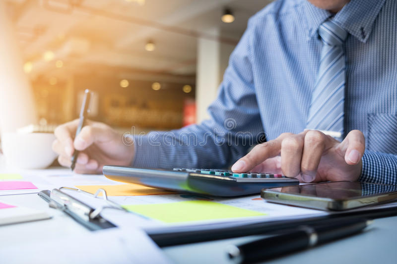 Business finance man calculating budget numbers, Invoices and financial adviser working stock image