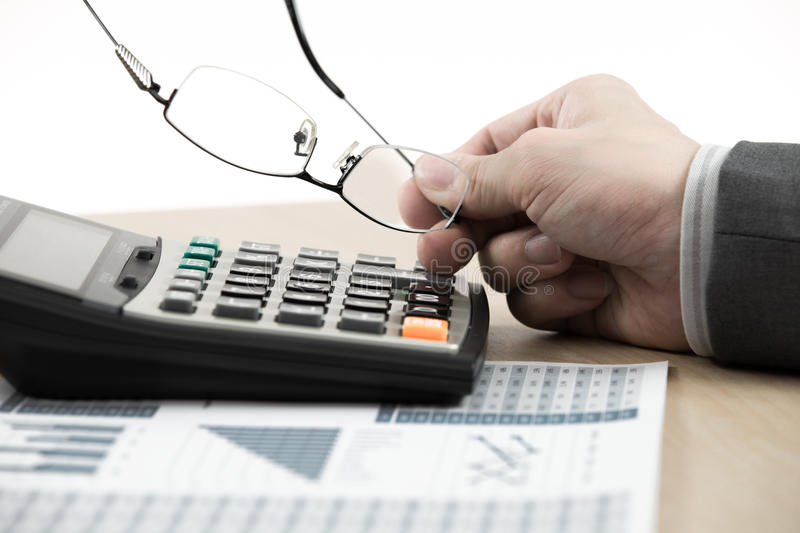 Business finance man calculating budget numbers. On table stock photo