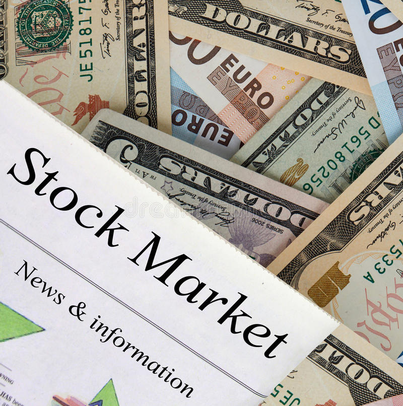 Business and Finance. Newspaper with Stock Market headline. World currency in the background royalty free stock photo