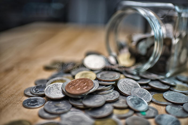 Business finance. save money for investment concept money in the. Glass High Dynamic Range tone stock images