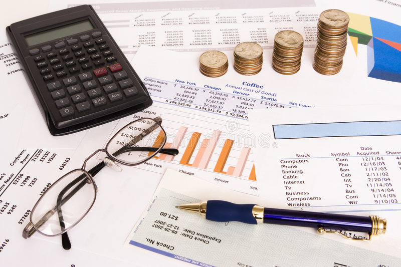 Business finances. Small business finances objects with glasses and pen royalty free stock image