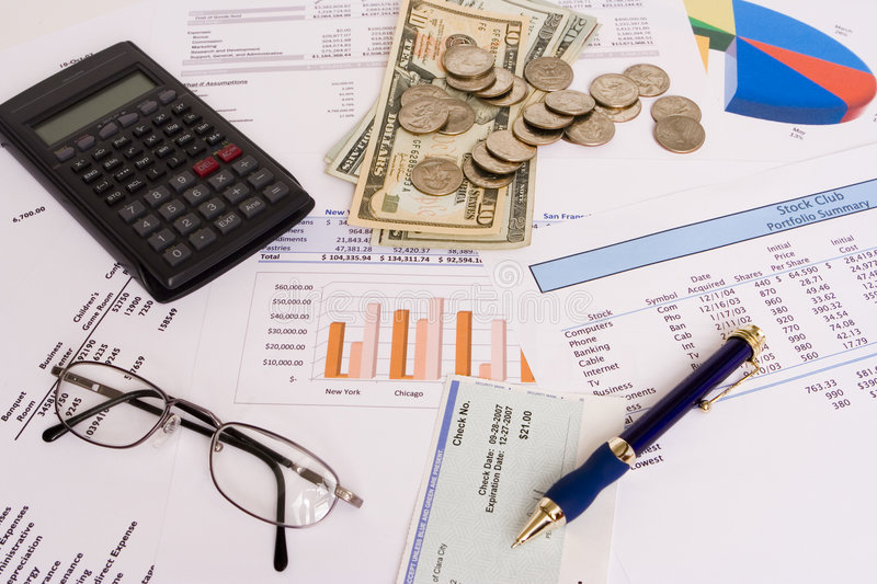 Business finances. Small business finances objects with glasses and pen stock photo