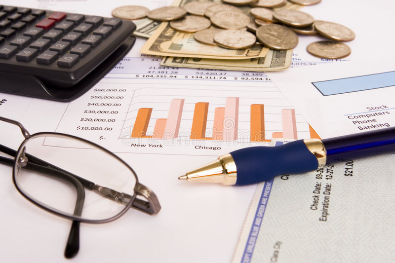 Business finances. Small business finances objects with glasses and pen stock photos