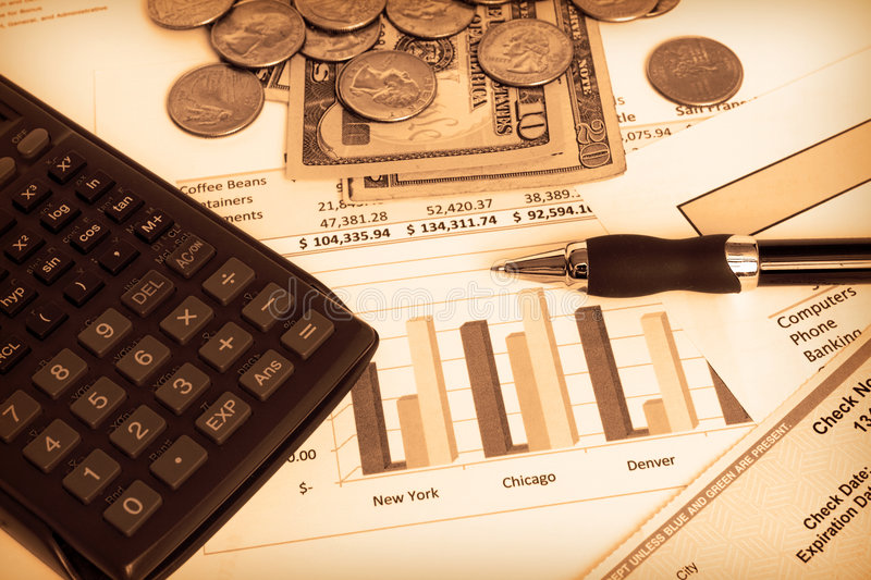 Business finances. Small business finances objects with calculator and pen in sepia stock photography