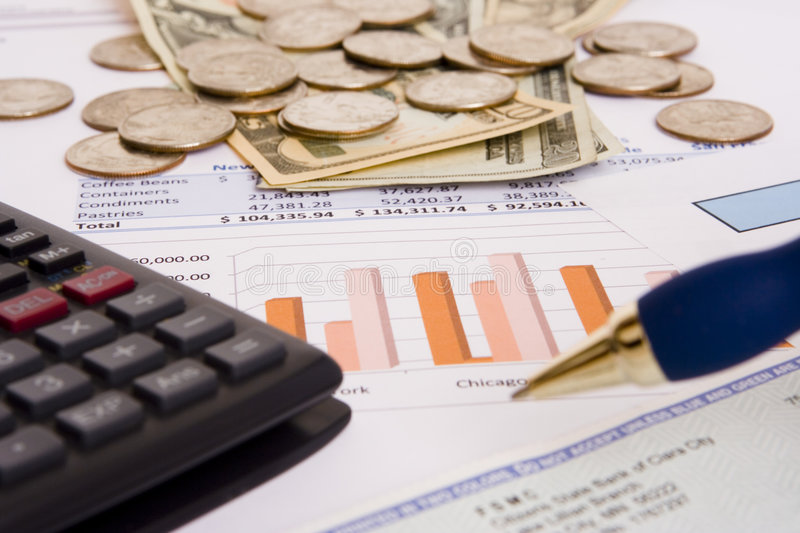 Business finances. Small business finances objects with calculator and pen stock photos
