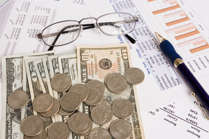 Business finances. Small business finances objects with glasses and pen royalty free stock photography