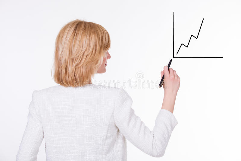 Business, finances and economics - attractive. Young businesswoman writing a graph. Female on white background. Backside view stock images